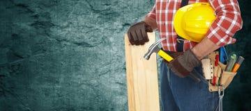 Bouwer met hamer en houten planken Royalty-vrije Stock Fotografie