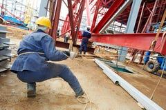Bouwersarbeider bij bouwwerf Royalty-vrije Stock Foto's