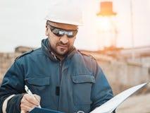 Bouwersingenieur en bouw stock afbeelding