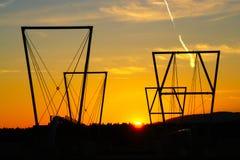 Bouwsilhouet bij Zonsondergang Royalty-vrije Stock Afbeeldingen