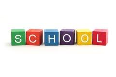 Bouwstenen die School spellen Stock Foto's