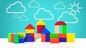 Bouwstenenstuk speelgoed over vloer Stock Afbeelding