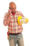 Bouwvakker bij de telefoon Stock Fotografie