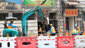 Bouwvakker en bulldozer stock foto