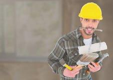 Bouwvakker met hulpmiddelen voor bouwwerf stock afbeelding