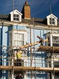 Bouwvakkers die Huis herstellen Royalty-vrije Stock Afbeelding