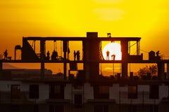 Bouwwerf op zonsondergang Stock Afbeelding