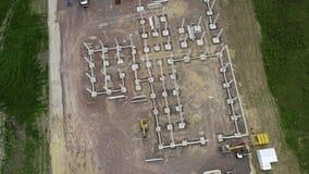 Bouwwerf van een industrieel gebouw - satellietbeeld stock videobeelden