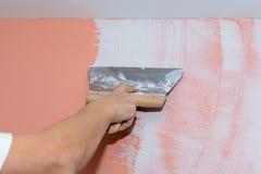 Bouwwerkzaamheden, stopverf en nivellerende muren Stock Afbeelding