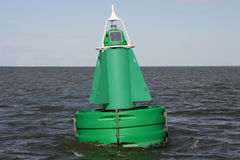 Bouy. A green buoy in the water Stock Photos