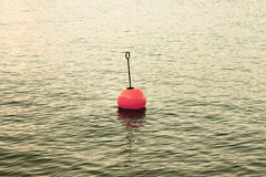Bouy by the lake. Red bouy on a calm lake Stock Images