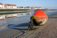 Bouy lying on the coast Royalty Free Stock Photos