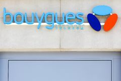 Bouygues Telecom logo on wall of a store. Lyon, France - August 15, 2016:  Bouygues Telecom logo on wall of a store. Bouygues Telecom is a French mobile phone Royalty Free Stock Image