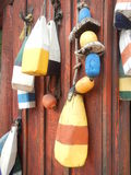 No bouys on shore. Colorful bouys on rustic wooden wall Royalty Free Stock Image