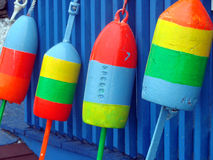 Bouys at Dockside. A series of colorful bouys at a fishing pier Stock Image