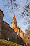 Bouzov castle with wall in Czech republic. Beautiful Bouzov castle with wall in Czech republic during nice springtime day royalty free stock photos