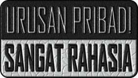 Bovenkant - geheime particuliere sector in de taal van Indonesië stock fotografie