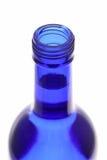 Bovenkant van geopende blauwe fles Stock Foto