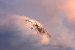 Bovenkant van Zwitserse Eiger in wolken en avondzon Royalty-vrije Stock Foto