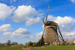 Bovenmolen windmill. Of the first of three windmill at Leischendam called Bovenmolen. It is a smock mill draining water from the prairie to another to keep the royalty free stock images