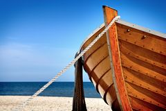 Bow. Front view of a wooden fishing boat, sea in background and blue sky with copyspace Stock Images
