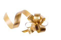 Bow. Golden bow for gifts and special occasions like Christmas or birthday, white isolated, clipping path included Royalty Free Stock Photography