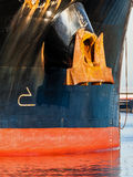 Bow anchor on ship. Old rusty anchor on the bow of a large cargo ship Royalty Free Stock Photography