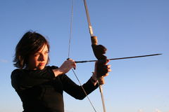 Bow and arrow. Young woman holding bow and arrow Royalty Free Stock Image