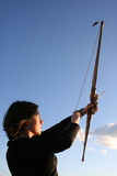 Bow and arrow. Young woman holding bow and arrow Stock Photos