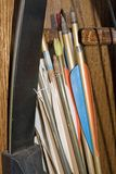 Bow and Arrows. A bow with arrows stored in a cabinet waiting to be used stock photo