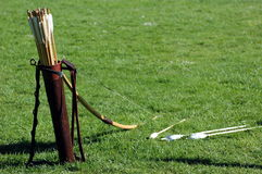 Bow arrows copy space. Old bow and arrows lying on a grass Royalty Free Stock Photos