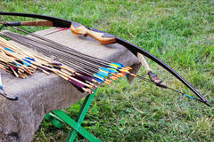 Bow and arrows on small table. Royalty Free Stock Photo