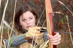 Bow and arrows. Woman hunting in nature with bow Royalty Free Stock Photos