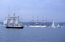 Bow and backboard of big sailship. Backboard of big Russian fullrigger Sedov with four masts setting sails before Tall Ships race. Other vessels around her Stock Photography
