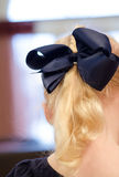 Blue hair bow. A blue bow in a childs long blonde hair Royalty Free Stock Photos