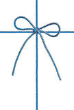 Bow from a blue cord Royalty Free Stock Image
