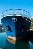 The bow of a blue greek ship in harbor at morning Royalty Free Stock Photo