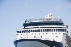 Bow of Blue and White Cruise Ship. Bow of blue and white luxury cruise ship under blue skies Royalty Free Stock Photo
