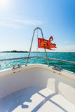Bow of boat floating in the sea with Venice flag. Stock Photography