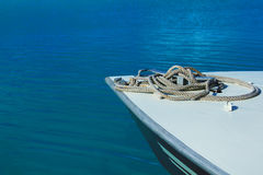 Bow of boat with rope in blue water in Bora Bora Royalty Free Stock Images