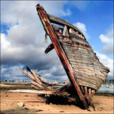 The Bow. Boats graveyard bow rust beach cloudy sky royalty free stock photo