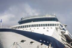 Bow and Bridge of Blue and White Cruise Ship. The bow and bridge of a large blue and white luxury cruise ship Royalty Free Stock Photos