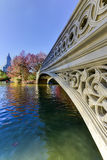 Bow Bridge, Central Park in Autumn. The Bow Bridge is a cast iron bridge located in Central Park, New York City, crossing over The Lake and used as a pedestrian Stock Image