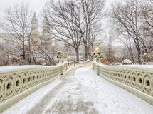 Bow bridge Central Park during snow storm. The Bow Bridge  is a cast iron bridge located in Central Park, New York City, crossing over The Lake Stock Images