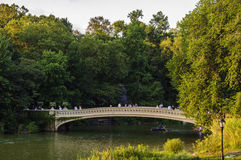 Bow Bridge. A cinematic bridge in The Lake of Central Park, popular with the locals and tourists alike Stock Images