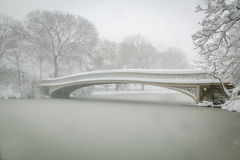 Bow Bridge covered in snow, Central Park, NYC Royalty Free Stock Photography
