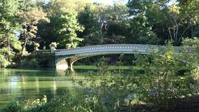 Bow Bridge. The Bow Bridge, the largest and one of the best known bridges in Central Park stock video footage