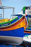 Traditional Maltese fishing boat, Bugibba. The bow of a brightly painted traditional Dghajsa boat in a boatyard, Bugibba, Malta, Europe Stock Photo