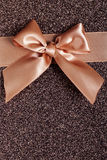 Bow on a brown background Royalty Free Stock Photography