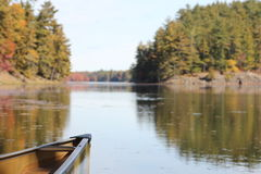 Bow of canoe on calm lake Royalty Free Stock Photos